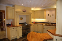 Yellow painted kitchen with Cherry worktops