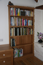 Fitted bookcase, tucked into an alcove.