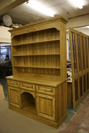 Stained Ash dresser with foldaway doors under construction seen behind.