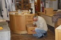 Putting the finishing touches to fitting a drawer.