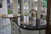 Another view, this shows contrasting Silestone quartz tops, a flush fitting cover hides a circular under-mount sink.