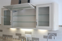 Modern style wall cabinet Gloss Beige, letterbox feature lift-up door, glazed cabinets each side.
