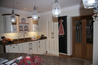 This view shows also a pair of doors leading into the hallway, made to compliment the kitchen.