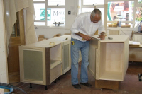 Gordon working on some base cabinets.