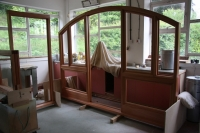 Bespoke feature window and door frame in the process of being oiled.