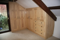 Commissioned fitted wardrobes made in solid Ash and fitted into sloping ceiling.