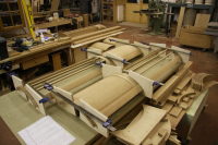 Curved doors being glued up, special cradles were made for this operation.