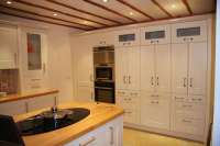 Modern kitchen Shaker style. Soft cream painted on Oak