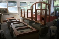 Frames and doors in the process of being oiled.