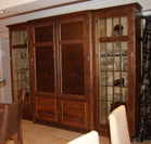 Tall Walnut dresser with Maple interiors, glazed cabinets and Burr Walnut feature panels.