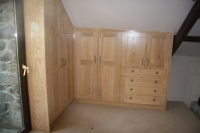 Another view of the solid Ash wardrobes, interiors is in Ash veneer