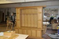 Dresser designed to fit one side of a chimney breast.