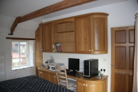 This picture shows traditional solid Oak furniture, in this view a dressing table / desk.