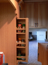 Pull-out spice rack in false chimney.