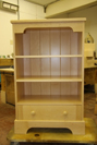 Small bookcase with storage drawer.