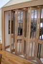 Internal glazed foldaway doors, made in Oak with Walnut detailing.