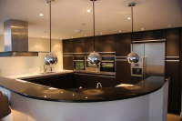 Modern style kitchen with curved peninsular feature