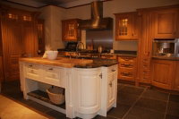 Showing off the island, this kitchen is an other example of painted cabinetry and wood combinations.Worktops are Granite.