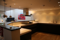 Modern style kitchen with curved peninsular feature showing the internal view